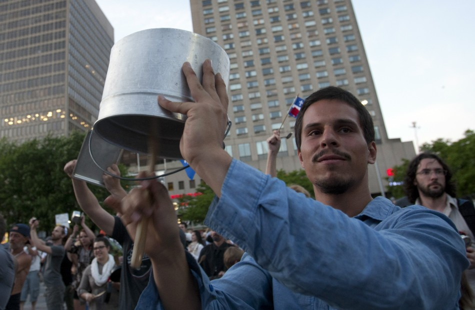 Students strike pots and pans as they take part in protest march against tuition fee hikes in Montreal