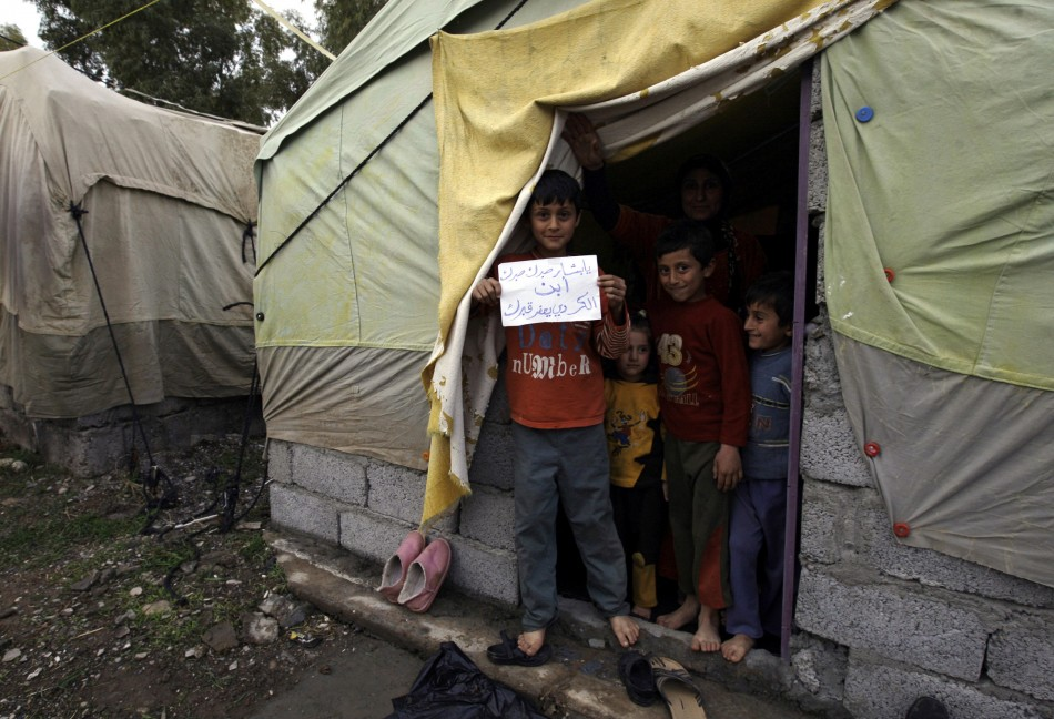 Syrian refugees of Kurdish origin have been flooding across the border into Iraq