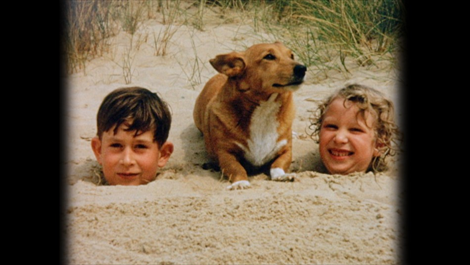 SOLE USE WITH THIS STORY ONLY. COPYRIGHT LAPSES 31.12.12 A young Prince Charles and Princess Anne being buried in the sand at Holkham beach, Norfolk