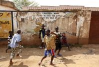 Children play in the street in Kisenyi, a slum in Kampala