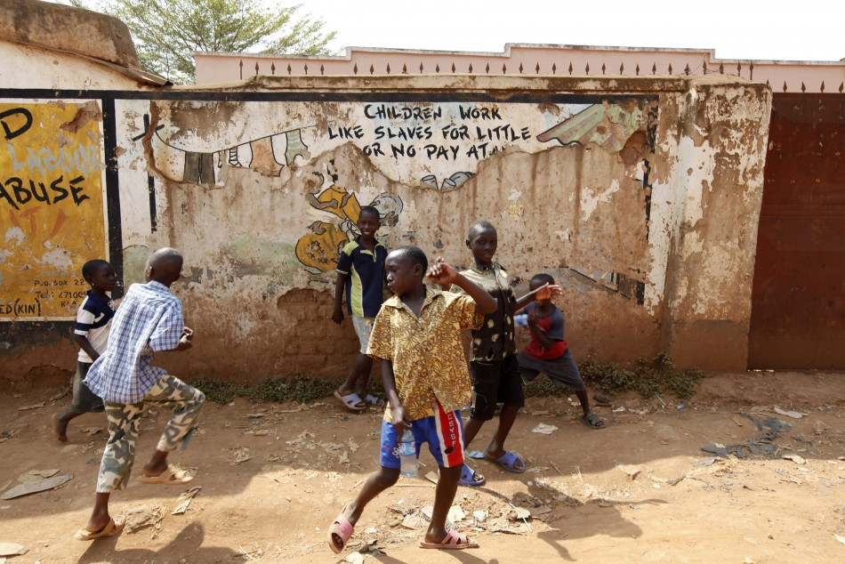 Children play in the street in Kisenyi, a slum in Kampala