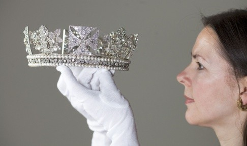 Exhibition Curator Caroline de Guitaut holds Diamond Diadem. (Photo: The Royal Collection)