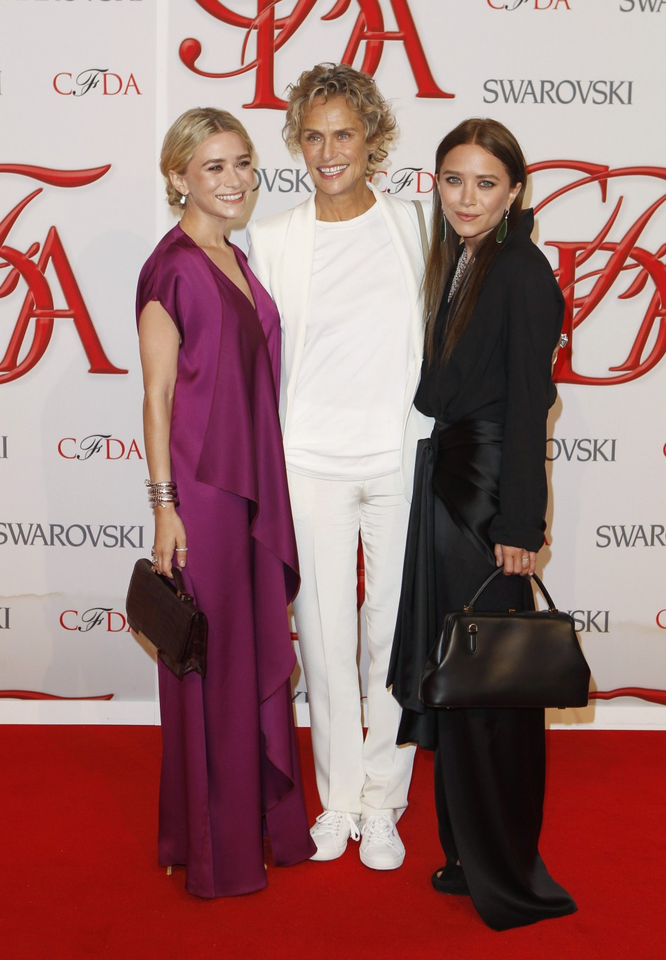 Actresses and designers Ashley and Mary-Kate Olsen arrive with actress Hutton to attend the 2012 CFDA Fashion Awards in New York