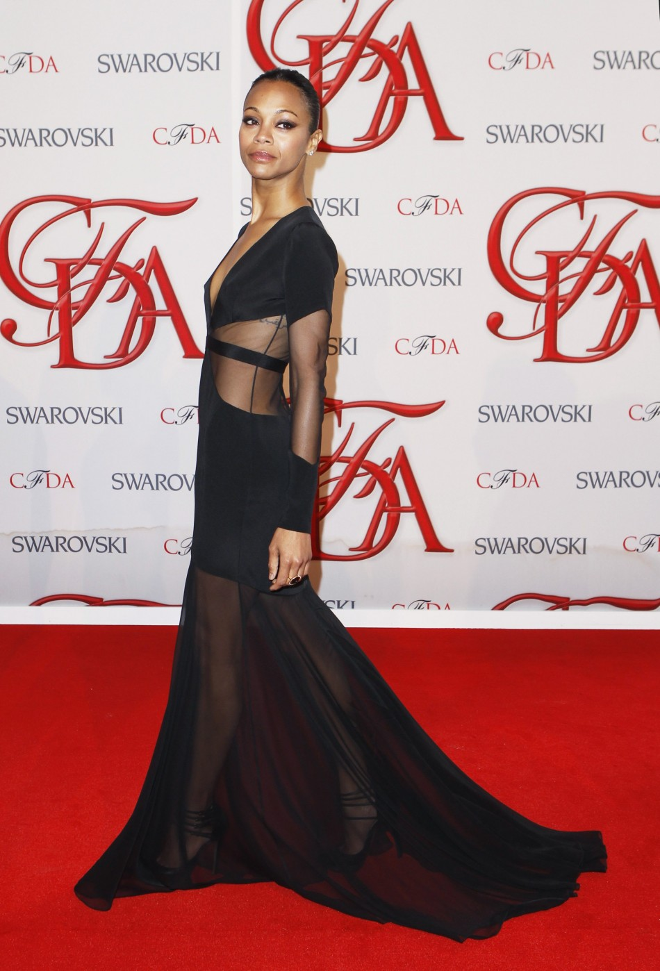 Actress Saldana arrives to attend the 2012 CFDA Fashion Awards in New York