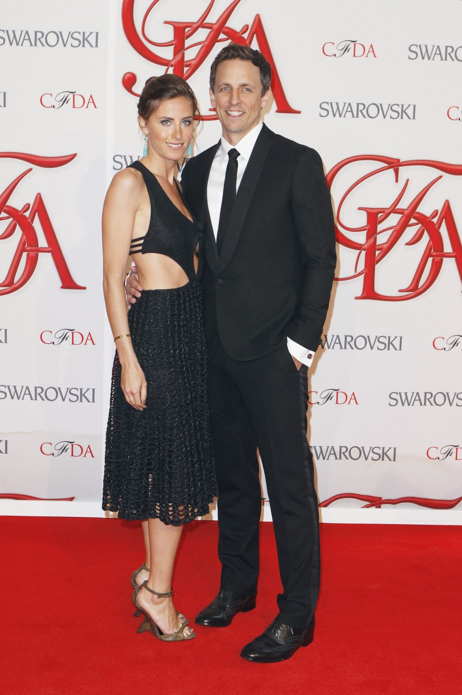 Comedian Meyers arrives with Ashe to attend the 2012 CFDA Fashion Awards in New York