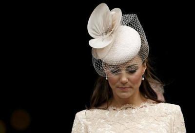 Kate Middleton Opts for fake earrings
