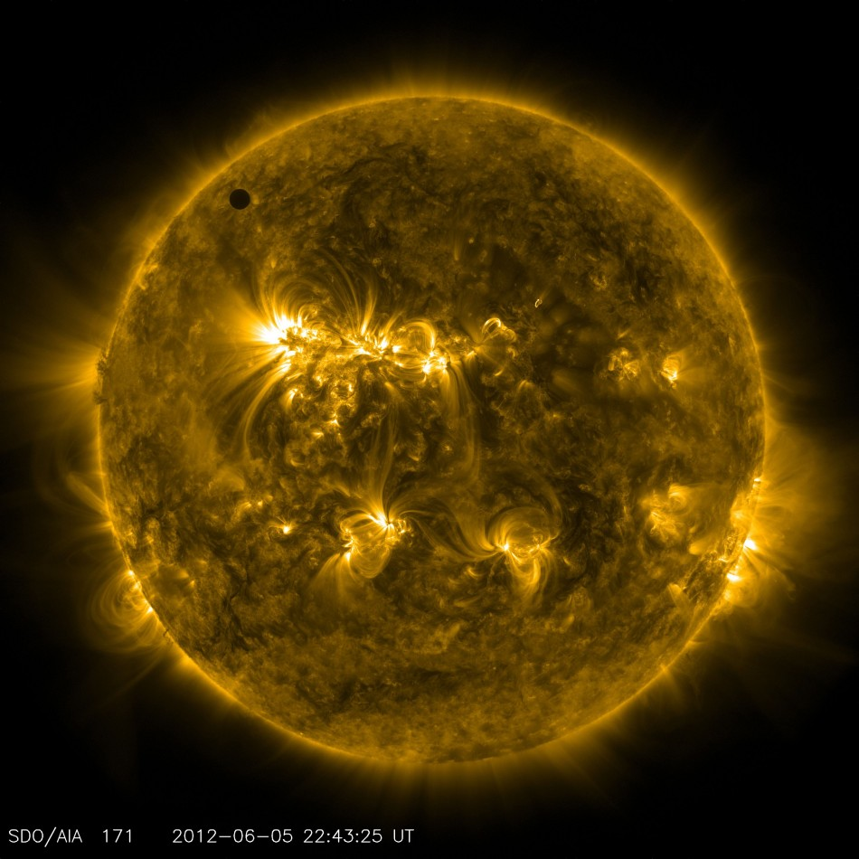 NASA image shows the planet Venus at the start of its transit of the Sun