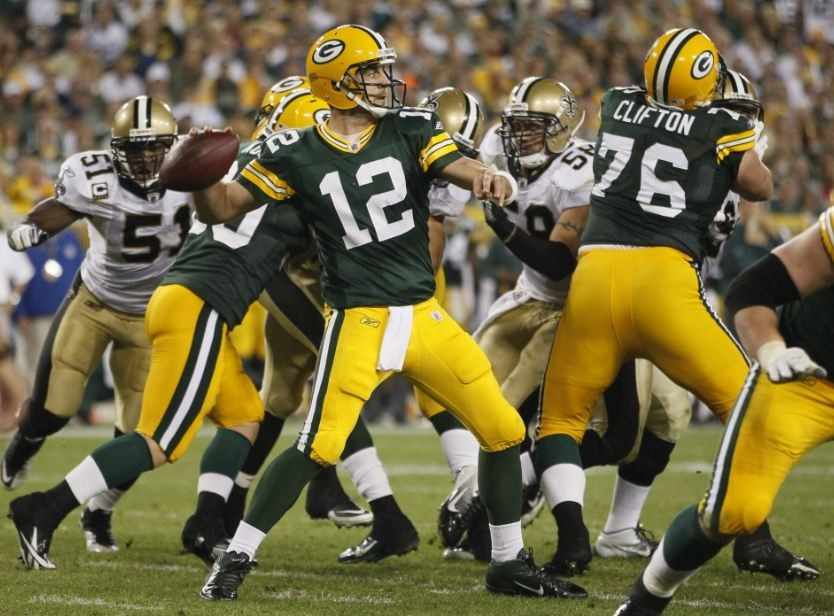 Green Bay Packers quarterback Aaron Rodgers (12) throws a pass against the New Orleans Saints during the second half of their NFL football game in Green Bay, Wisconsin, September 8, 2011.