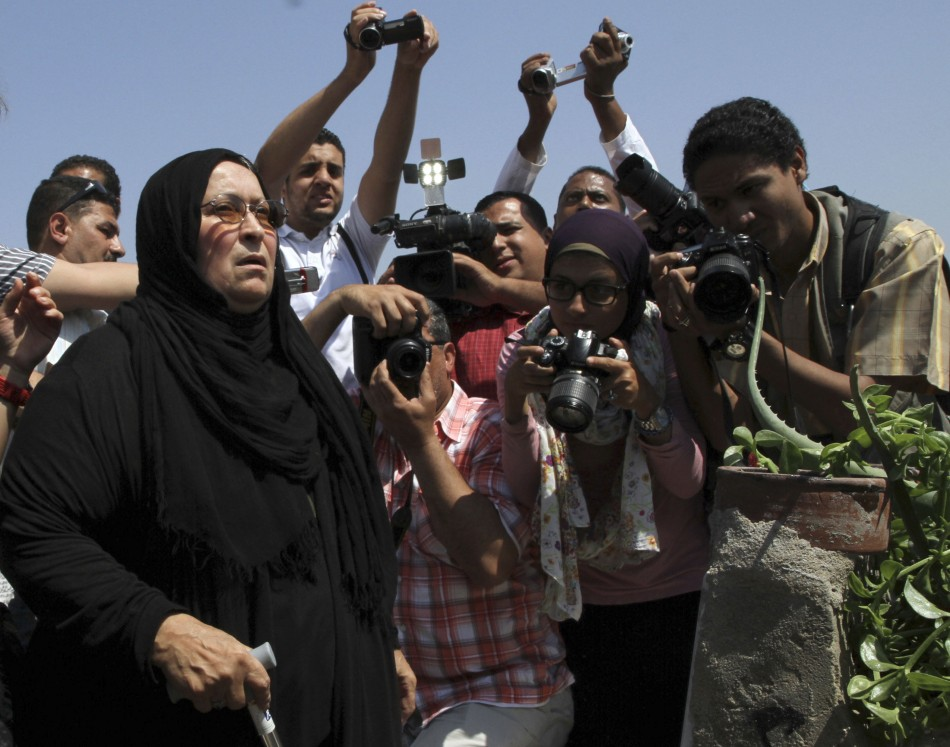 Laila Marzouk, mother of Egyptian activist Khaled Said prays by Said's grave on the second anniversary of his death in the port city of Alexandria, Reuters