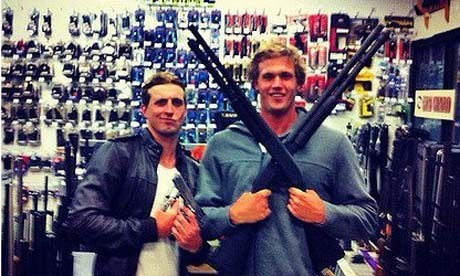 Australian Olympic swimmers Nick D'Arcy and Kenrick Monk posing with guns (Facebook)