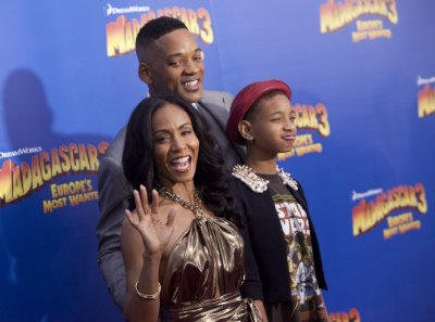 Cast member Jada Pinkett Smith, her daughter Willow Camille Reign Smith and husband actor Will Smith, arrive for the premiere of quotMadagascar 3 Europes Most Wantedquot in New York