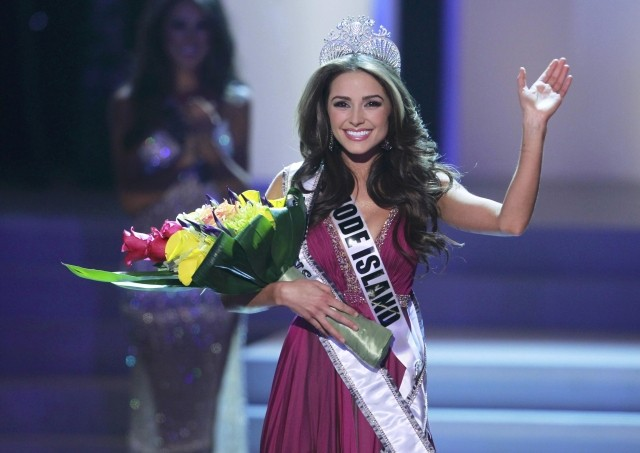 Miss Rhode Island Olivia Culpo waves after being crowned during the Miss USA pageant at the Planet Hollywood Resort