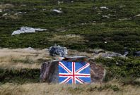 A rock with the Union Jack flag painted on it is seen near Port Stanley, Falkland Islands, March 11, 2012.