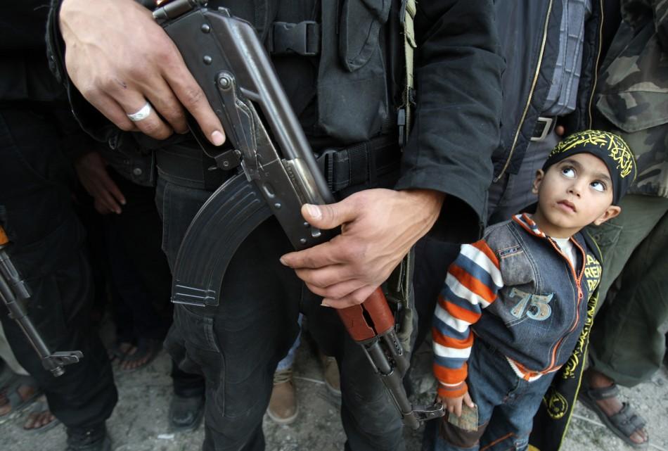 Children attending Islamic Jihad-run kindergarten in Gaza celebrate graduation by wearing army uniforms