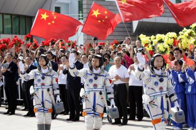 Chinese astronauts Jing Haipeng, Liu Wang and Liu Yang