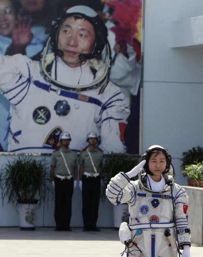 Chinas first female astronaut Liu Yang salutes