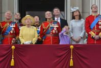 Members of Britain's Royal family watch a flypast by the Red Arrows as they stand on the balcony of Buckingham Palace following the Trooping the Colour ceremony in central London