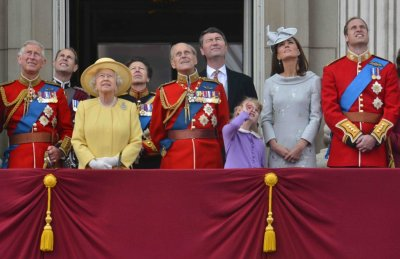 Members of Britain039s Royal family watch a flypast by the Red Arrows as they stand on the balcony of Buckingham Palace following the Trooping the Colour ceremony in central London