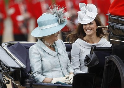 Britain039s Camilla, Duchess of Cornwall, and Catherine, Duchess of Cambridge travel to Horse Guards Parade for the Trooping the Colour ceremony in central London