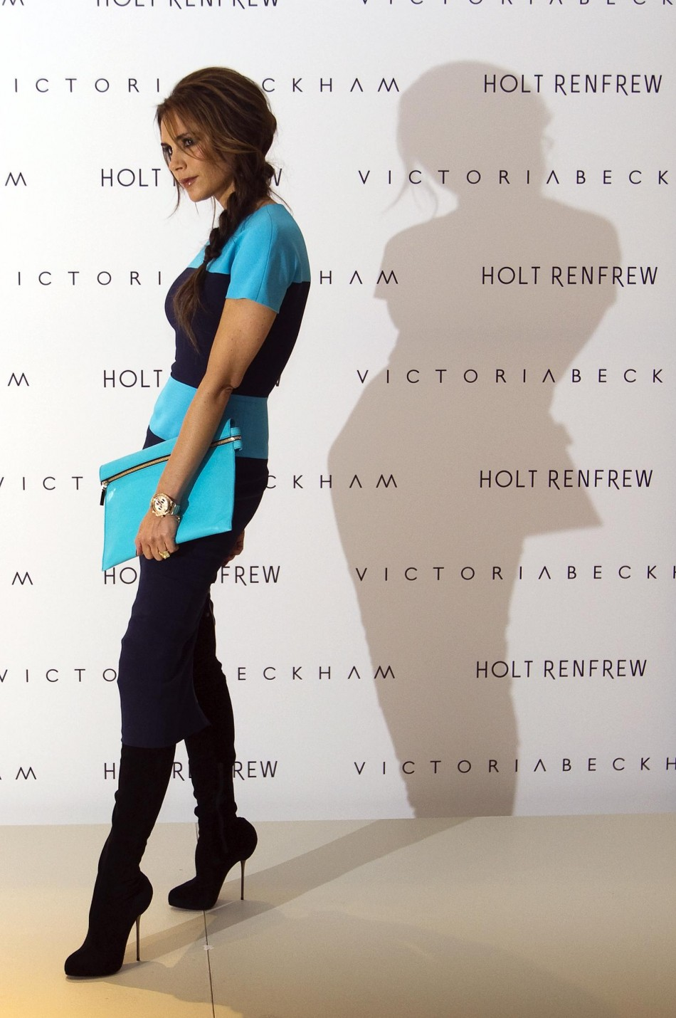 Victoria Beckham poses for the media and fans at Holt Renfrew Vancouver while in town prompting her fashion line in Vancouver