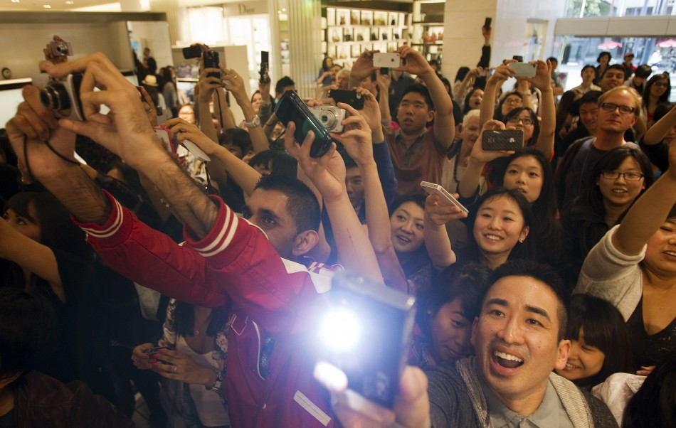 Fans greet Victoria Beckham at Holt Renfrew Vancouver as she promotes her fashion line in Vancouver