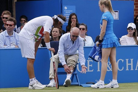 David Nalbandian will be investigated by police after injuring line judge (Reuters)