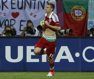 Nicklas Bendtner displays the name of Irish bookmaking firm Paddy Power on the waistband of his underpants during their Group B Euro 2012 match against Portugal (Reuters)