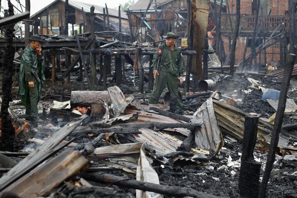 Soldiers patrolneighbourhood burned in recent violence in Sittwe