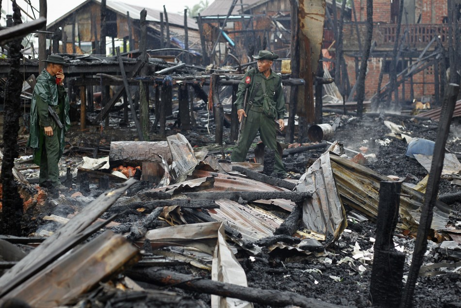 Soldiers patrolneighbourhood burned in recent violence in Sittwe