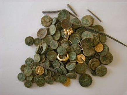 The gold and silver coins that were discovered during an excavation of a building dating to the Roman and Byzantine period in Israel. (Photo: Israel Antiquities Authority)