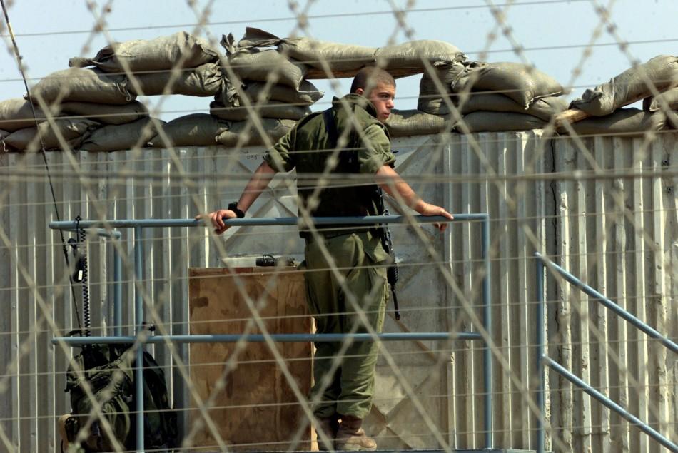 ISRAELI SOLDIER AT POST ON GREEN LINE IN BAT HEFER.