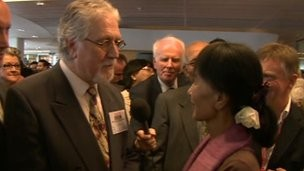 presenter Dave Lee Travis met Aung San Suu Kyi during her visit to the BBC's, BBC Burmese service
