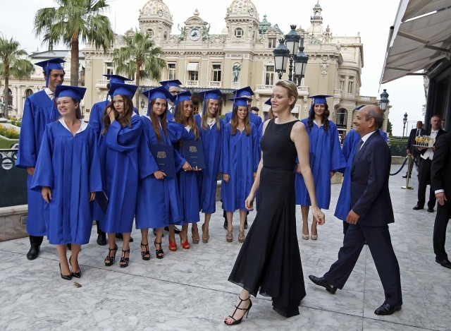 Princess Charlene Enlivens a Graduation Gala in Monte Carlo in Sleek Black Dress