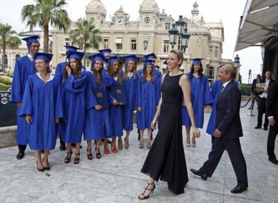 Princess Charlene Enlivens a Graduation Gala in Monte Carlo in Sleek Black Dress