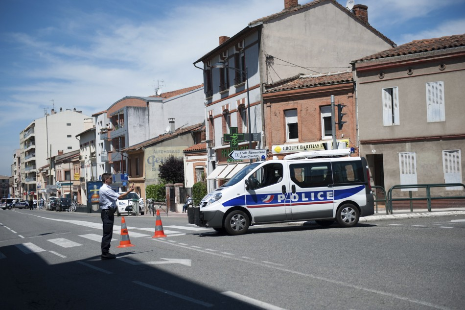 Police block the street at the scene where a man claiming to be a member of al Qaeda has taken four hostages in a bank in Toulouse