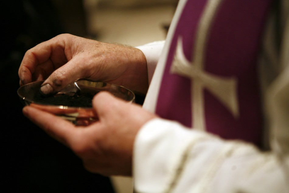 Roman Catholic Archbishop of Hartford Henry J. Mansell rebuked the Rev. Michael DeVito, of the Sacred Heart Church in Suffield, Conn.