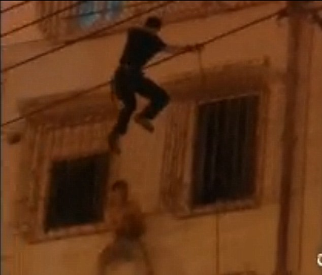 Abseiling Police Officer stops Man committing suicide