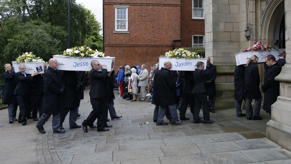 The coffins of six children who died in a house fire are carried into St Mary's Church for their funeral service in Derby (Reuters)