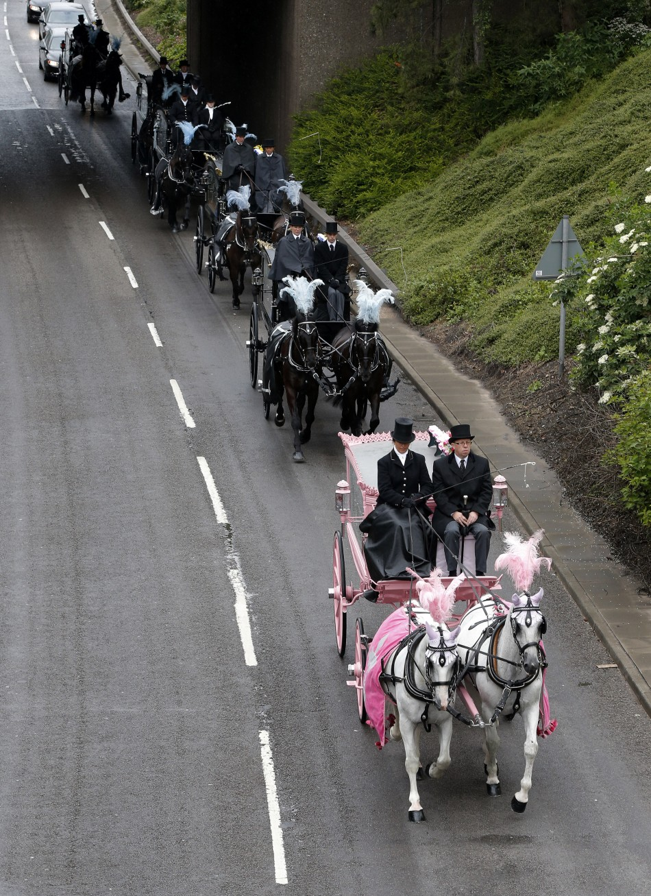The coffins were taken to the church through Derby via horse drawn hearses (Reuters)