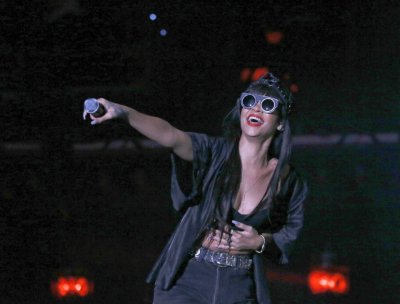 Rihanna performs, during a surprise appearance with Jay Z, at the Hackney Weekender festival at Hackney Marshes in east London