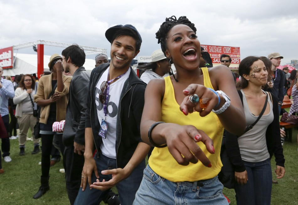Festival goers dance during a DJ set at the Hackney Weekender festival at Hackney Marshes in east London