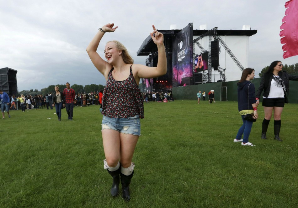 A woman dances near the main stage at the Hackney Weekender festival at Hackney Marshes in east London
