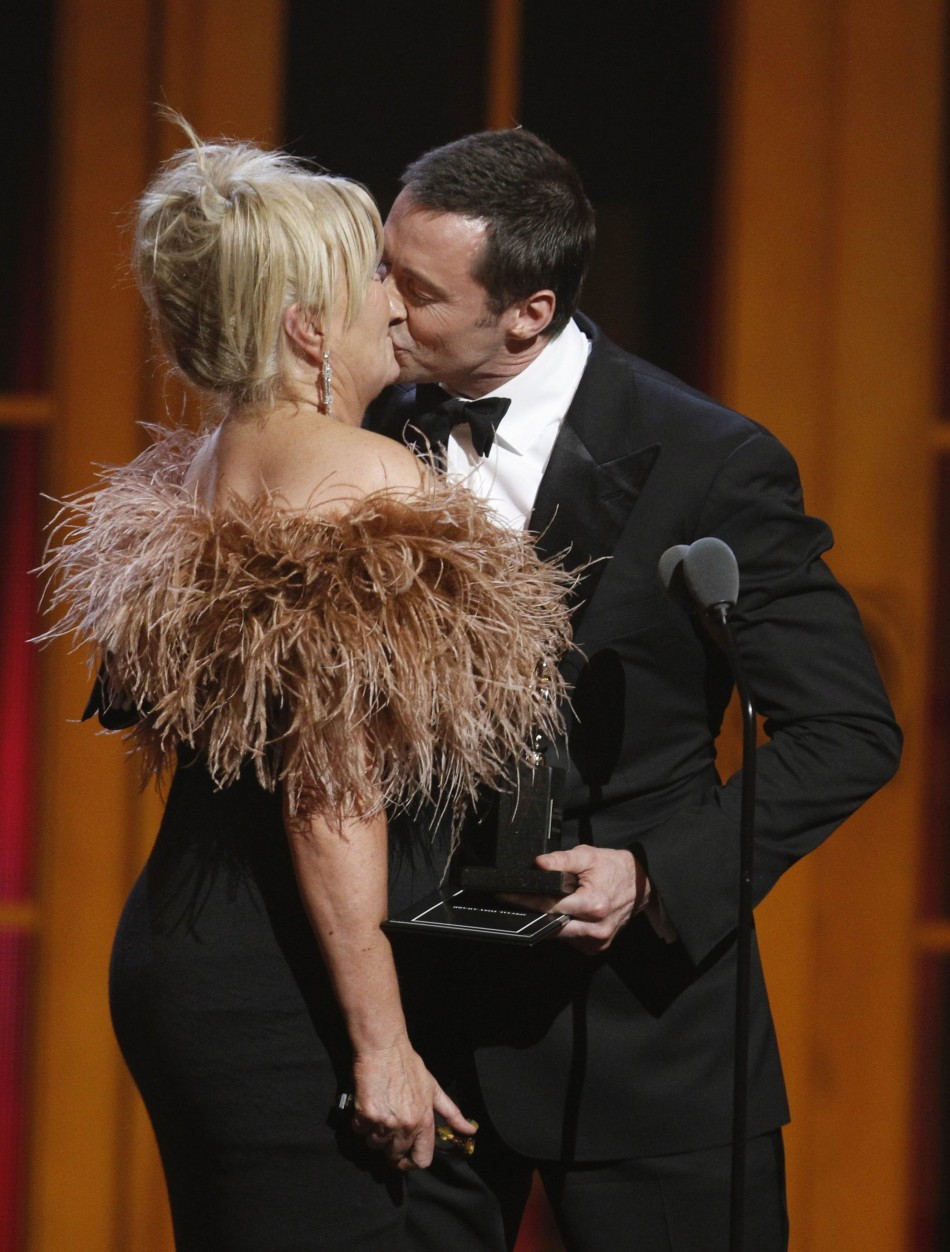 Actor Jackman kisses his wife Furness after she presented him a special Tony award during the American Theatre Wings 66th annual Tony Awards in New York