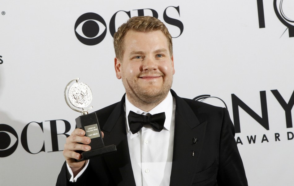 "James Corden poses backstage with his award for best performance by an actor in a leading role in a play for ""One Man, Two Guvnors"" during the American Theatre Wing's 66th annual Tony Awards in New York"