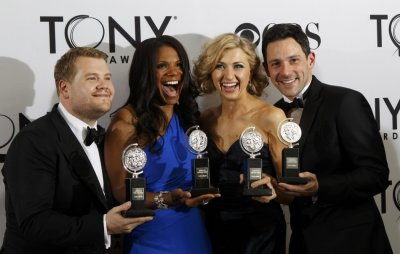 James Corden, Audra McDonald, Nina Arianda, and Steve Kazee pose backstage with their awards during the American Theatre Wings 66th annual Tony Awards in New York