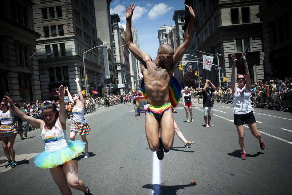 Marchers participate in the Gay Pride Parade in New York