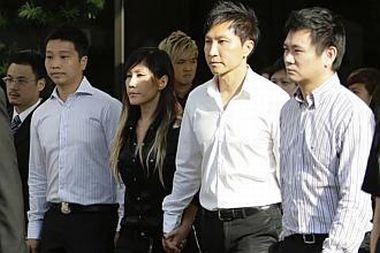 Kong Hee (second right) with his singer wife Ho Yeow Sun, known professionally as Sun Ho (Reuters)