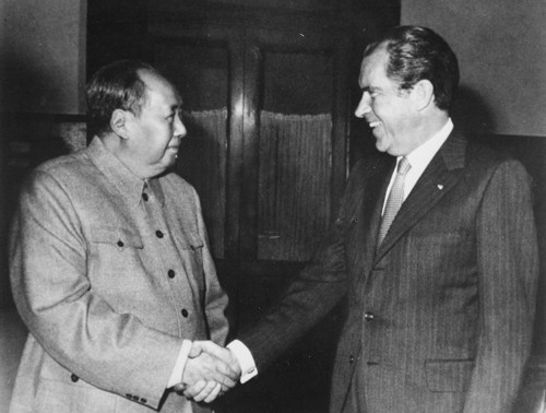 Former  U.S. President Richard Nixon, with Chinese Communist leader Mao Zedong.