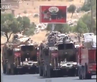 Turkey's state television said the country is deploying anti-aircraft weapons along the Syrian border.