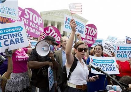 Supporters of the Affordable Healthcare Act celebrate in front of the Supreme Court after the court upheld the legality of the law in Washington (Reuters)